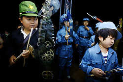 Members of 'Longzaitian' or 'Dragon in the Sky' Shadow Puppet Troupe prepare to perform with their puppets in a rehearsal for a show titled 'Findling the Anti-Japanese Hero' in Beijing, China, 28 May 2015. The troupe which consists of close to 50 members who look like children but are actually dwarfs with an average age of 22 and height of 1.26 metres