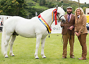 18/08/2016 repro free Martin Coyne and Cathy Snow Coyne with Moorland Snowy River winer of the Senior  Stallion Class at the 93rd annual Connemara Pony show in Clifden Co. Galway and Reserve Champion. Photo:Andrew Downes, XPOSURE