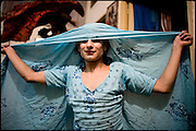 """Kastouri,  a young transvestite,16 years old, dances, with his dupatta (traditional scarf), for his Guru, to show what has learned. Transvestites people have created a community, a kind of an hierarchical staircase, based on rules handed down by generations. Night in Lahore, Pakistan on Monday, December 01 2008.....""""Not men nor women"""". Just Hijira, Kusra. Painted lips, Kajal surrounding their eyes and colourful veils..Pakistan is today considered a strongly, foundamentalist as well, islamic country. But under its reputation, above all over the talebans' continuos advancing, stirs a completely extraneous world, a multiethnic mixed society. Transvestites make part of it, despite this would not be admitted by a strict law. Third gender, the Hijira are born as men (often ermaphrodites) or with an ambiguous genital situation, and they have their testicles and penis removed through a - often brutal - surgical operation. The peculiarity is that this operation does not contemplate the reconstruction of a female organ. This is the reason why they are not considered as men nor women, just Hijira. They are often discriminated, persecuted  and taxed with being men prostitutes in the muslim areas. The members of this chast perform dances during celebrations, especially during weddings, since it is anciently believed that an EUNUCO's dance and kiss in the wedding day brings good luck to the couple's fertility...To protect the identities of the recorded subjects names and specific .places are fictionals."""