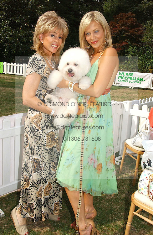 SALLY FARMILOE with her dog Pasha and tv presenter LIZ FULLER at the Macmillan Cancer Support Dog Day held in the gardens of the Royal Hospital, Chelsea, London on 4th July 2006.<br />