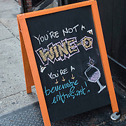 Humorous sign outside of wine store.
