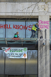 Members of Extinction Rebellion protested at Shell headquarters in London. The group sprayed graffiti on the building, and climbed onto a glass ledge where they poured a black substance down the wall. <br /> <br /> Richard Hancox | EEm 15042019