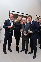 Left to right, PIERS BECKWITH, JESS CUMMINGS, SIR JOHN BECKWITH and CHARLIE FREEMAN at a private view of photographs by wildlife photographer David Yarrow included in his book 'Encounter' held at The Saatchi Gallery, Duke of York's HQ, King's Road, London on 13th November 2013.