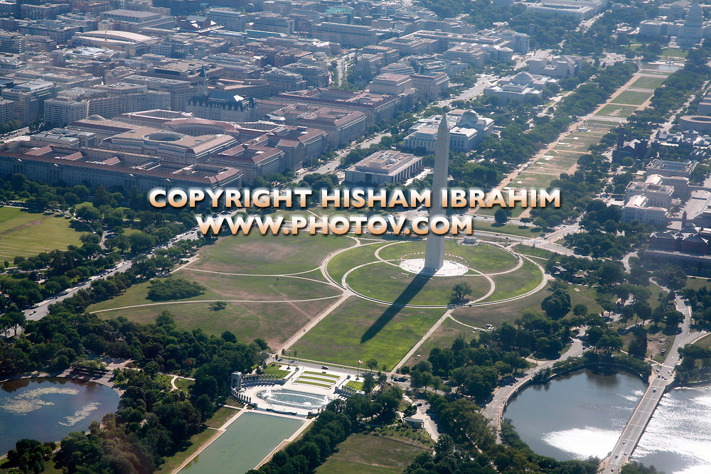 Aerial view of The Washington Monument and National Mall, Washington DC, USA. Featuring World War II Memorial, Constitution Avenue, Smithsonian Institution museums, IRS Headquarters Building, Department of Justice and the US Capitol Building.