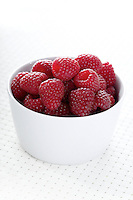Raspberries in white bowl - close-up