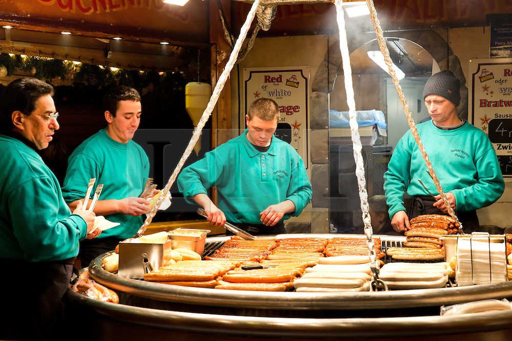 © Licensed to London News Pictures. 29/11/2013. Birmingham, UK. Birmingham Frankfurt Market. Pictured, German Frankfurt sausages have become a speciality at the market. Birmingham hosts the largest outdoor Market in the Country every year. The annual Frankfurt German Market, has visited Birmingham for the last 12 years and is bigger than ever before this year. The market has even more stalls, 190 in total. An ice rink and ferris wheel complete the winter wonderland that draws thousands to the city centre over the build up Christmas. Photo credit : Dave Warren/LNP