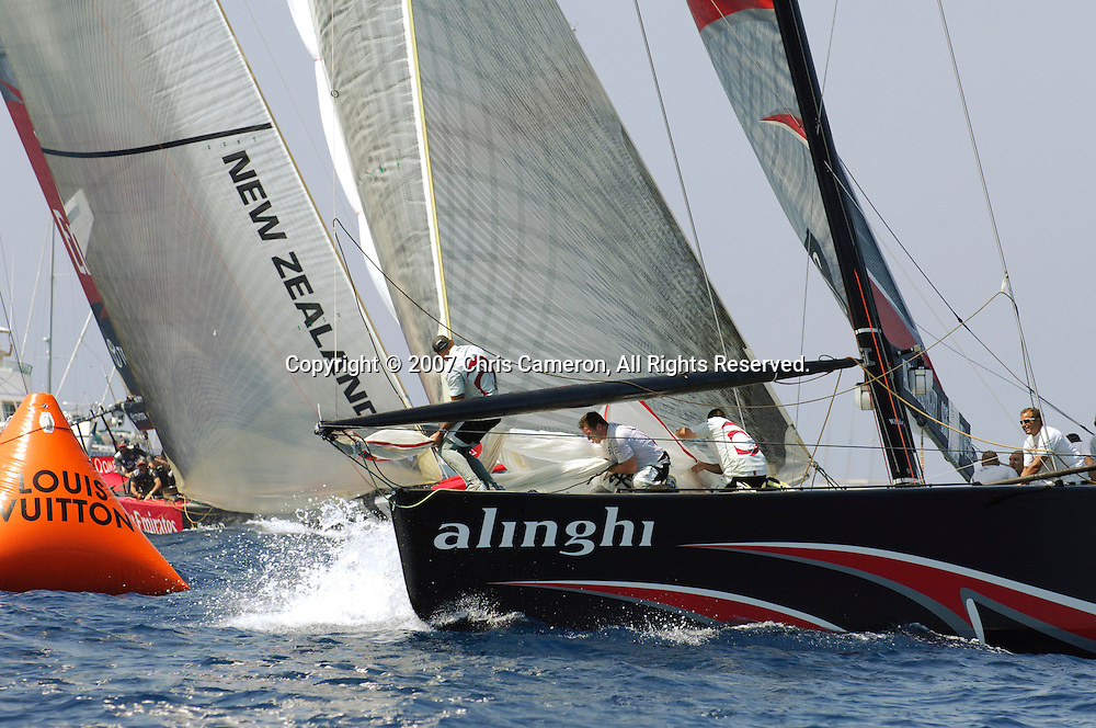 Alinghi SUI100 rounds the last mark 16 seconds ahead of Emirates Team New Zealand NZL92 in race six of the 32nd America`s Cup. 30/6/2007