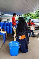 A pregnant women receives a SPRINT-IPPF dignity kit at a RH Medical Mission in the Taluksangay Barangay Hall, Zamboanga, Mindanao, The Philippines on November 5, 2013. These Internally Displaced People (IDP) had taken refuge in this Barangay (neighbourhood) after surviving the 3 week long attack by MNLF rebels. Photo by Suzanne Lee for SPRINT-IPPF