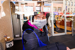 People wear protective masks to fend off the CoronaVirus, while street vendors pedal masks, hand sanitiser and other disinfecting products in Queens, New York.