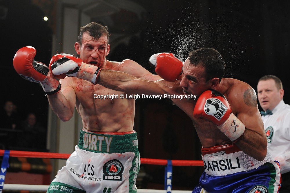 Emiliano Marsili (blue shorts) defeats Derry Matthews for the Vacant IBO Lightweight Title. Vaughan Boxing Promotions. © Leigh Dawney 2012