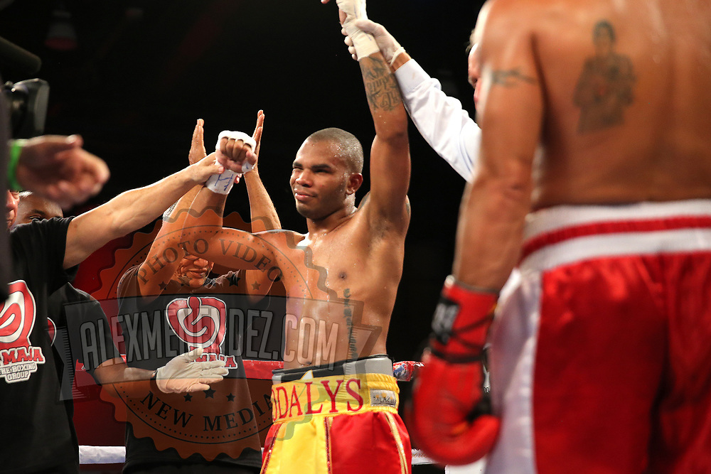 Hairon Socarras celebrates a victory over Luis Diaz during a Telemundo boxing match between at Osceola Heritage Park on Friday, February 23, 2018 in Kissimmee, Florida.  (Alex Menendez via AP)