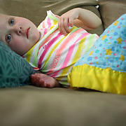Holly Larue Frizzelle lies on the couch of her family home in Wilmington, N.C. She was on a steroid for Leukemia that increased her appetite and made her very lethargic. On December 27, 2012 two year old Holly Larue Frizzelle was diagnosed with Acute Lymphoblastic Leukemia. What began as a stomach ache and visit to her regular pediatrician led to a hospital admission, transport to the University of North Carolina Children's Hospital, and more than two years of treatment.