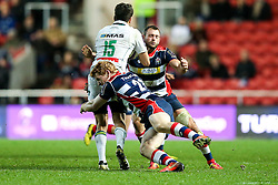 Charly Malie of Pau is tackled by Jack Tovey and Luke Arscott of Bristol Rugby - Rogan Thomson/JMP - 11/12/2016 - RUGBY UNION - Ashton Gate Stadium - Bristol, England - Bristol Rugby v Pau - European Rugby Challenge Cup.