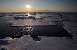 ATLANTIC OCEAN ABOARD ARCTIC SUNRISE 31MAY11 - Arctic sea ice during sunset in the Labrador Sea seen from aboard the Greenpeace Ship Arctic Sunrise.....jre/Photo by Jiri Rezac / Greenpeace