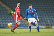 Ollie Rathbone clears during the EFL Sky Bet League 1 match between Rochdale and Walsall at Spotland, Rochdale, England on 23 December 2017. Photo by Daniel Youngs.