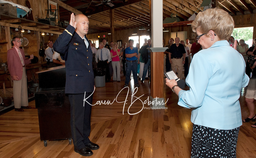 (Karen Bobotas/for the Laconia Daily Sun)Laconia Police Chief Christopher A. Adams' swearing in ceremony at Pitman's Freight Room in Laconia May 31, 2011.Laconia Police Chief Christopher A. Adams' swearing in ceremony at Pitman's Freight Room in Laconia May 31, 2011.  Karen Bobotas/for the Laconia Daily Sun