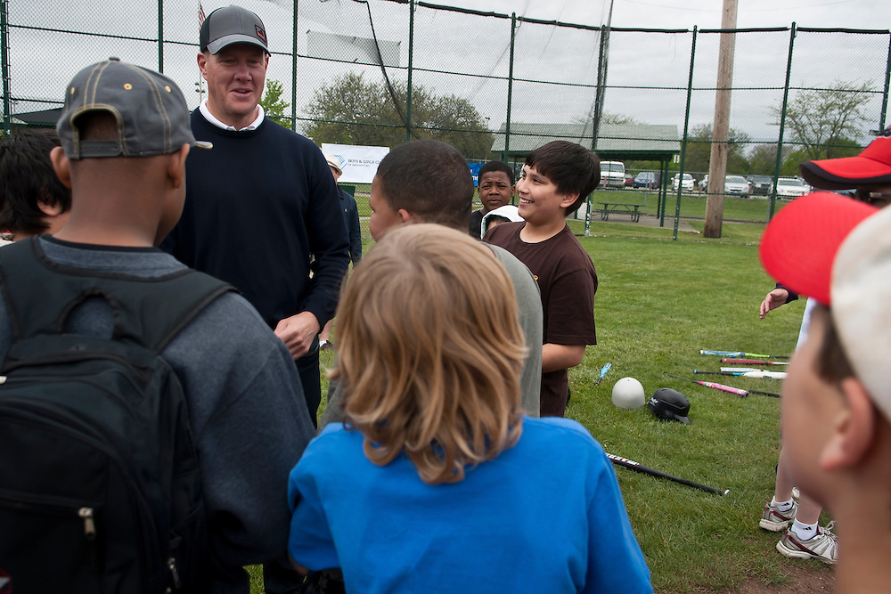 Lathan Goumas | MLive.com..May 5, 2012 - Former professional baseball player Jim Abbott talks to kids during a Pitch Hit & Run event sponsored by the Boys & Girls Club of Greater Flint on Saturday at Broome Park in Flint, Mich. Abbott, who grew up in Flint, signed autographs and posed for pictures with the kids through out the event.
