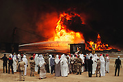 The Crown Prince of Kuwait visiting the oil well fires for the first time in May which were set immediately after the end of the Gulf War. The royal family fled and when they returned they finally went out to see the burning Magwa oil fields near Ahmadi, Kuwait. More than 700 wells were set ablaze by retreating Iraqi troops creating the largest man-made environmental disaster in history.