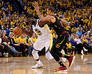May 31, 2018; Oakland, CA, USA; Golden State Warriors forward Draymond Green (23) drives to the basket against Cleveland Cavaliers guard George Hill (3) during the third quarter in game one of the 2018 NBA Finals at Oracle Arena.