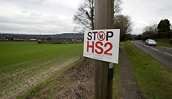 © Licensed to London News Pictures. 27/01/2012. Amersham, UK. A 'Stop HS2' sign (High Speed Rail 2) next to fields in Amersham, Buckinghamshire. Under current plans, the new Rail system will run through the Buckinghamshire town. Photo credit : Ben Cawthra/LNP