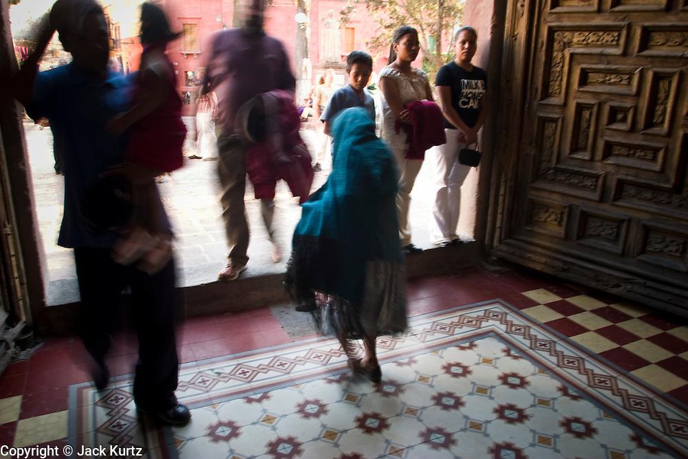 An elderly woman leaves a Catholic church in San Miguel de Allende, Mexico. PHOTO BY JACK KURTZ
