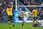 Twickenham, United Kingdom, Englands' Ben YOUNGS, clears the ball over left.  Kane DOUGLAS and left Michael HOOPER, during the 2013 QBE Autumn<br /> Rugby International, England vs Australia, played<br /> Saturday  02/11/2013.  RFU Stadium Twickenham,<br /> England. [Mandatory Credit: Peter Spurrier/Intersport<br /> Images]