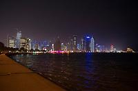 """08 APR 2013, DOHA/QATAR<br /> Downtown Doha mit den Hochhaeusern (auf der rechten Seite) Palm Towers, Tornado Tower, Al Bidda Tower, Qatar World Trade Center, und Doha Tower, auch """"Condom Tower"""" (rechts), gesehen von der Al Corniche Street<br /> IMAGE: 20130408-01-048<br /> KEYWORDS: Katar, Hochaus, Wolkenkratzer, Tower, Skyscraper, Nacht, Nachtaufnahme, night,"""