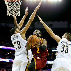 Nov 22, 2013; New Orleans, LA, USA; Cleveland Cavaliers point guard Kyrie Irving (2) shoots past New Orleans Pelicans power forward Anthony Davis (23) and power forward Ryan Anderson (33) during the second half of a game at New Orleans Arena. The Pelicans defeated the Cavaliers 104-100. Mandatory Credit: Derick E. Hingle-USA TODAY Sports