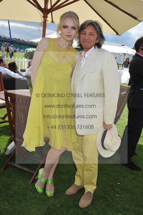 KATIA ELIZAROVA and LEON MAX at the 27th annual Cartier International Polo Day featuring the 100th Coronation Cup between England and Brazil held at Guards Polo Club, Windsor Great Park, Berkshire on 24th July 2011.