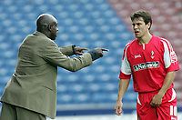 Photo: Paul Thomas.<br /> Huddersfield Town v Swindon Town. Coca Cola League 1. 29/10/2005. <br /> <br /> Swindon manager Iffy Onuora gives some instructions to Stefani Miglioranzi.