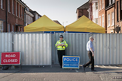© Licensed to London News Pictures. 06/07/2018. Salisbury, UK. A police road block remains in place outside a hostel in Salisbury town centre after couple, named locally as Dawn Sturgess, 44, and her partner Charlie Rowley, 45, were taken ill on Saturday 30th June 2018. Police have confirmed that the couple have been in contact with Novichok nerve agent. Former Russian spy Sergei Skripal and his daughter Yulia were poisoned with Novichok nerve agent in nearby Salisbury in March 2018. Photo credit: Peter Macdiarmid/LNP