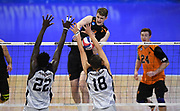 Princeton Tigers middle blocker George Huhmann (3) attempts to hit the ball past Pepperdine Waves middle blocker Kevin Vax (22) and setter Robert Mullahey (18) during an NCAA Championships opening round match, Wednesday, April 30, 2019, in Long Beach, Calif. Pepperdine defeated Princeton 25-23, 19-25, 25-16, 22-25, 15-8.