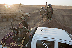 20/10/2016. Bashiqa, Iraq. Kurdish peshmerga fighters advance at the beginning of a large offensive to retake the Bashiqa area from Islamic State militants today (20/10/2016).<br />