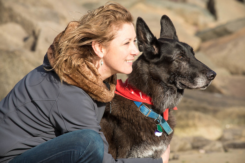 Zorro the German Shepherd with his mom in the morning on a beach in Quincy MA