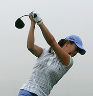 Michelle Wie of the US hits on the driving range during a delay due to fog during the first day of the US Women's Open Golf Championship at Newport Country Club in Newport Rhode Island, Thursday  29 June 2006