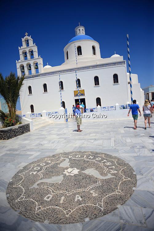 Oia Main Square, also known as Nicolaou Nomikou Square, with Greek Orthodox Church Panagia of Platsiani, Santorini.