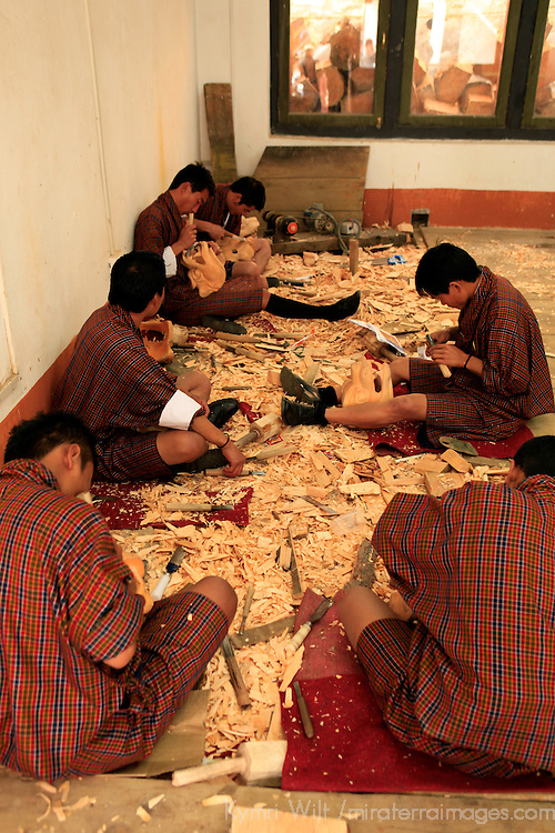 Asia, Bhutan, Thimpu. Woodcarving students at the National Institute for Zorig Chusum, or traditional arts and crafts.