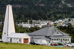 After being absent from the historic Fort Seward skyline since approximately the 1930s, the 60-foot tower of the fort&rsquo;s fire hall has been restored to its original height. The building and tower, built around 1904 in Haines, Alaska, was shortened to approximately half its height in the 1930s for unknown reasons. The restoration included rebuilding a missing 35-foot section of the 60-foot tower whose purpose was to dry fire hoses. The tower restoration was completed by building its four sections on the ground and then hoisting those sections with a crane into place on top of each other.<br /> <br /> Through the years, the historic Fort Seward area, a former U.S. Army post, has been referred to as Fort William H. Seward, Chilkoot Barracks, and Port Chilkoot. The National Historic Landmarks listing record for the fort says that &quot;Fort Seward was the last of 11 military posts established in Alaska during the territory's gold rushes between 1897 and 1904. Founded for the purpose of preserving law and order among the gold seekers, the fort also provided a U.S. military presence in Alaska during boundary disputes with Canada. The only active military post in Alaska between 1925 and 1940, the fort was closed at the end of World War II.&rdquo; <br /> <br /> The bottom portion of the fire hall is being leased as commercial space. Due to fire code restrictions there is no public access to the upper portion of the tower. <br /> <br /> The fire hall was restored over a two-year period by owners Joanne Waterman and Phyllis Sage who also own the fort&rsquo;s original guardhouse located next door to the fire hall (right). That building, now known as the Alaska Guardhouse, is a bed and breakfast.