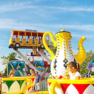 At the Feast of St. Rocco, young children ride the Spinning Tea Cups carnival ride, on July 14, 2012, in Oyster Bay, New York, USA. The Italian American Citizens Club organized the five-day festival, which ends July 15, to promote Italian-American heritage.