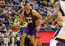 Jan 7, 2017; Morgantown, WV, USA; TCU Horned Frogs guard Kenrich Williams (34) dribble the ball during the first half against the West Virginia Mountaineers at WVU Coliseum. Mandatory Credit: Ben Queen-USA TODAY Sports