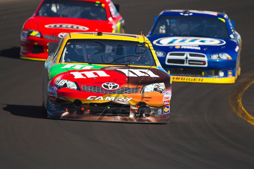 AVONDALE, AZ - MAR 04, 2012:  Kyle Busch (18) brings his car through turn 1 during the Subway Fresh Fit 500 race at the Phoenix International Raceway in Avondale, AZ.