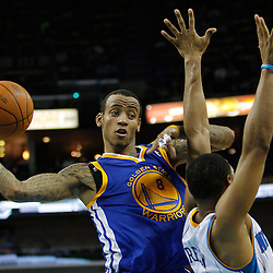 January 5, 2011; New Orleans, LA, USA; Golden State Warriors shooting guard Monta Ellis (8) passes as New Orleans Hornets shooting guard Willie Green (33) defends the play during the second half at the New Orleans Arena. The Warriors defeated the Hornets 110-103.  Mandatory Credit: Derick E. Hingle
