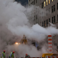 New York steam pipe in the middle of the fifth avenue.   Manhattan  / cheminee de vapeur du chauffage urbain sur la cinquieme avenue .