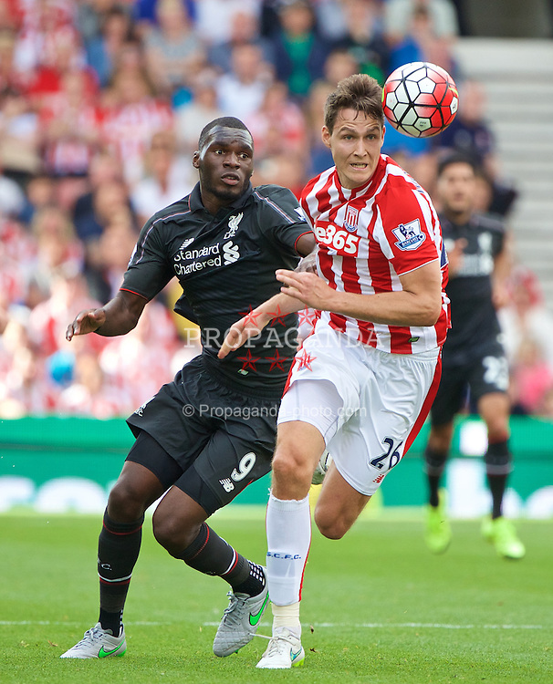 STOKE-ON-TRENT, ENGLAND - Sunday, August 9, 2015: Liverpool's Christian Benteke in action against Stoke City's Philipp Wollscheid during the Premier League match at the Britannia Stadium. (Pic by David Rawcliffe/Propaganda)