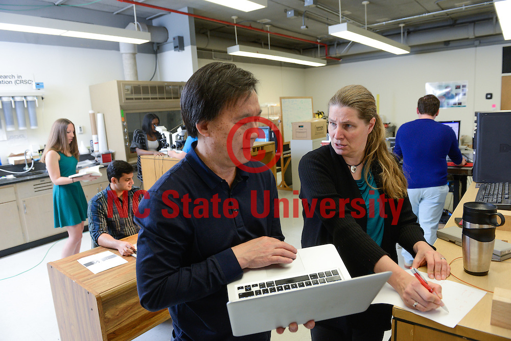 Students work in the Cardiovascular Dynamics Group lab with Mette Olufsen and Hien Tran. They are mathmatics faculty.