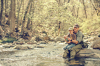 Father and son fly fishing for wild trout in the Blue Ridge Mountains of Virginia.