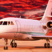 Side view at sunset on the tarmac.The Dassault Falcon 2000 is a French Business jet and a member of Dassault Aviation's Falcon business jet line, and is a twin-engine,  with transcontinental range.