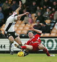 Photo: Paul Thomas.<br /> Port Vale v Bristol City. Coca Cola League 1. 17/12/2005.<br /> <br /> Port Vale's Andy Porter tries to get the ball from Bristol's Steve Brooker.