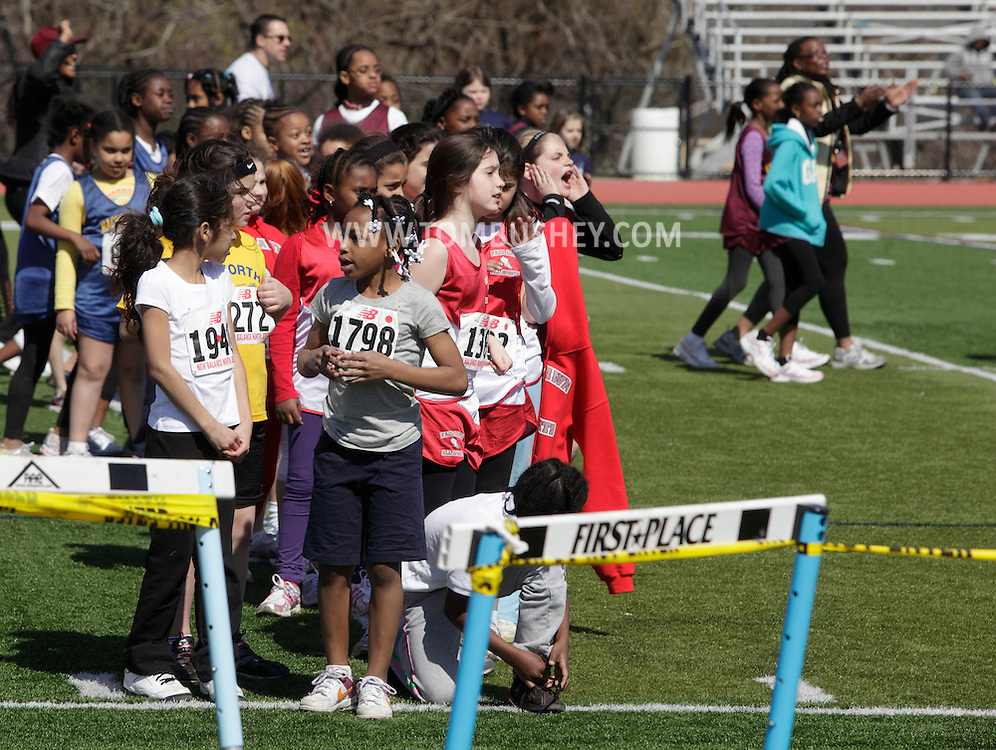 Mahwah, New Jersey - Girls wait in line to run in the 100-meter dash during a New Jersey Striders Spring Youth Developmental  track meet at Mahwah High School on April 17, 2011.