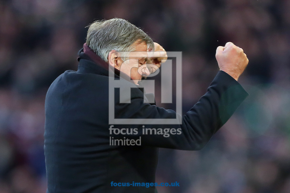 Manager of West Ham United, Sam Allardyce celebrates after Diafra Sakho of West Ham United scored his side third goal to make it 3-1 during the Barclays Premier League match at the Boleyn Ground, London<br /> Picture by Richard Calver/Focus Images Ltd +447792 981244<br /> 07/12/2014